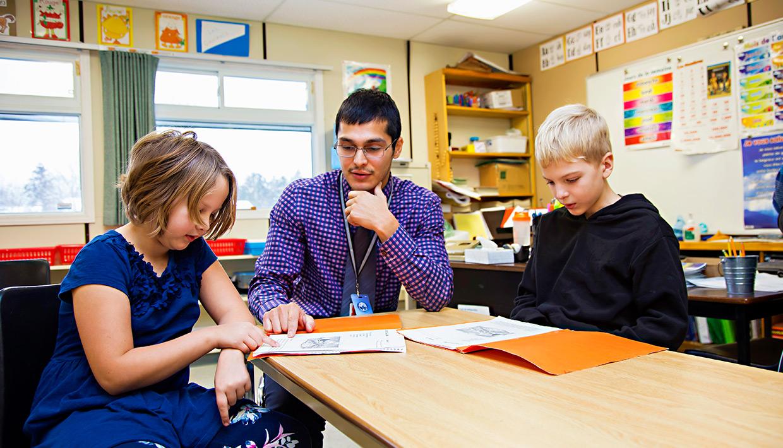 St.-Aloysius001-teacher-with-students